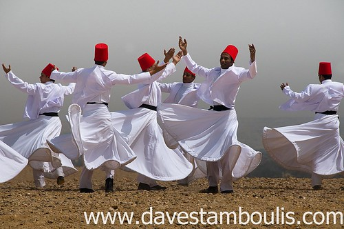 whirling dervish Sufi dancers in motion on the Giza plateau in Cairo Egypt