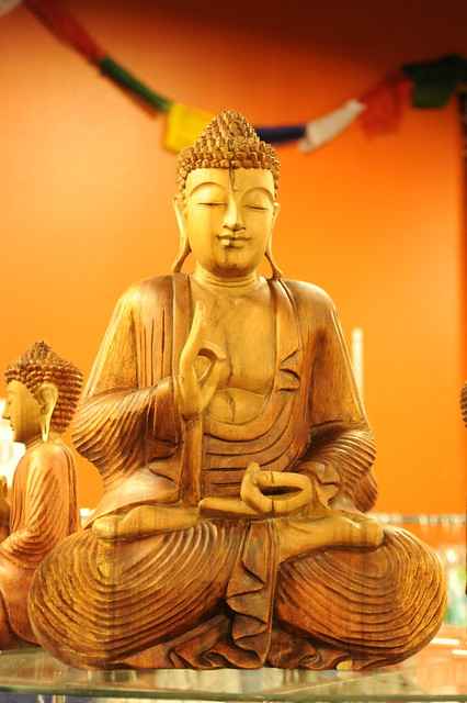 Carved Buddha Statue In Wood Slight Smile Eyes Closed
