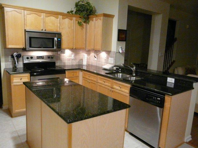 Black Granite Countertops With Natural Stone Backsplash