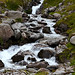 White mountain waters streaming among rocks