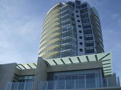 tower(0.0), tower block(1.0), building(1.0), skyscraper(1.0), property(1.0), commercial building(1.0), landmark(1.0), architecture(1.0), headquarters(1.0), brutalist architecture(1.0), condominium(1.0), facade(1.0),