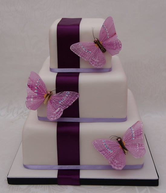 Vertical Butterflies Wedding Cake Inspiration came from a similar style by