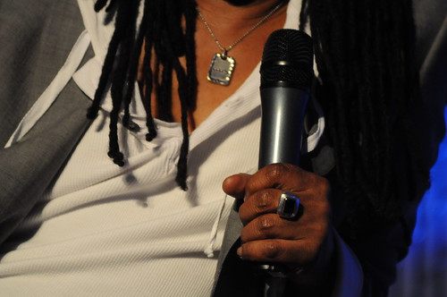 Nile Rodgers' left hand holding microphone