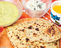 breakfast(0.0), paratha(0.0), baked goods(0.0), meal(1.0), bread(1.0), flatbread(1.0), produce(1.0), food(1.0), dish(1.0), cuisine(1.0),