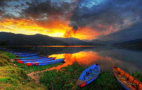 nepal sunsetreflection pokhara sunsetreflections pokharalake colorfulboats phewalakepokhara lakeinpokhara nepalsunset pokharasunset phewalakesunset sunsetsinnepal sunsetreflectedinwater