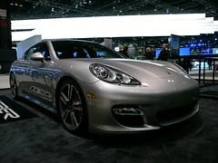 executive car(0.0), family car(0.0), automobile(1.0), automotive exterior(1.0), wheel(1.0), vehicle(1.0), performance car(1.0), automotive design(1.0), porsche(1.0), porsche panamera(1.0), rim(1.0), auto show(1.0), bumper(1.0), land vehicle(1.0), luxury vehicle(1.0), sports car(1.0),
