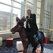 This is a photograph of @TimOReilly Riding a Donkey Statue at the 2010 Gov 2.0 Conference in Washington, D.C. You're welcome. by danxoneil