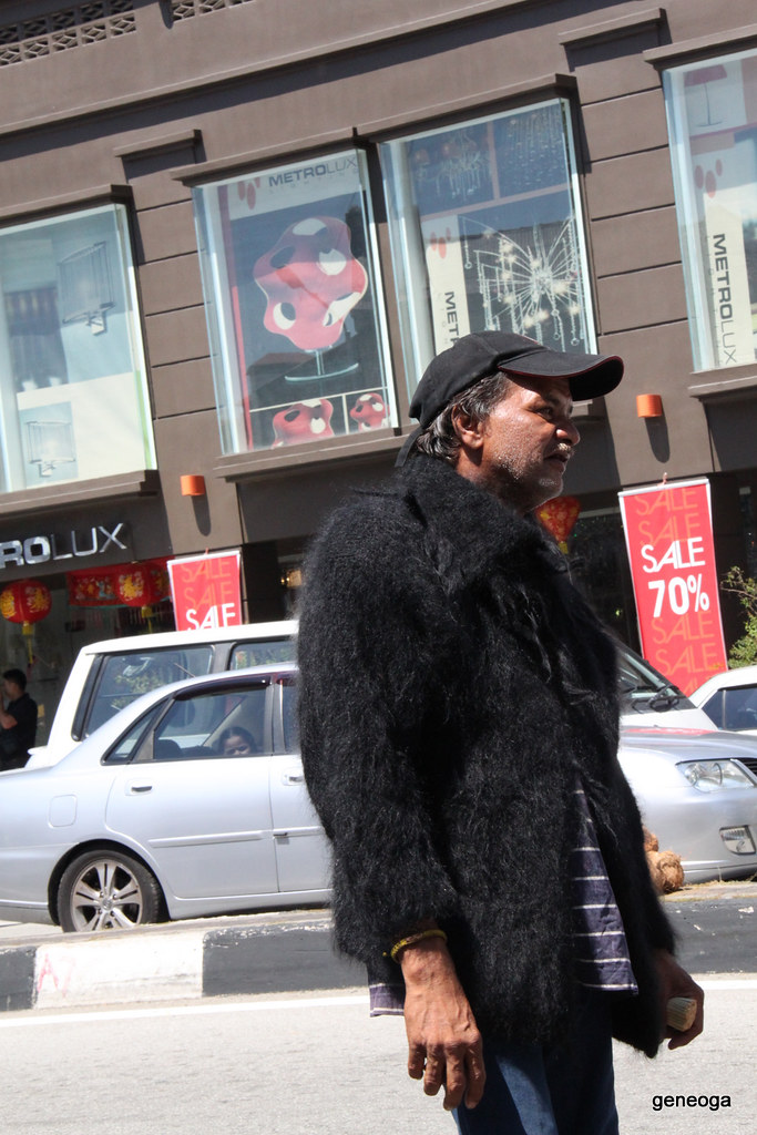Man with fur on a hot day
