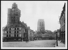 Grande Place in Bethune showing the clock tower in the foreground and the church tower in the background