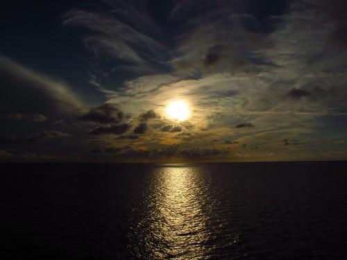 ocean sunset sea sky cloud sun water