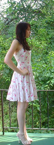 Bee Jones outdoors in simple lovely dress.