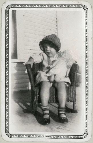 Child in Rocker with Doll