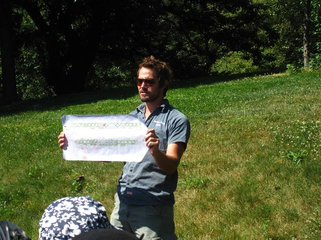 Curator Cayleb Long shows his design plan for the Annual Border display honoring BBG's Centennial.