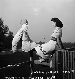 Woman worker for the Dominion Arsenals Ltd. munitions plant has a date with her boyfriend. / Une ouvrière de l'atelier de munitions de l'usine Dominion Arsenals Ltd. a un rendez-vous avec son ami