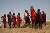 Two Lion Guardians celebrating the Games by jumping. In the Maasai culture, it is traditional for men to engage in this competitive jumping activity, which is used to show the murrans, or warriors', stamina and strength...and to impress the girls! These Lion Guardians are showing how high they can jump and having a great time in the process.   Learn more about the joint Panthera/Living with Lions Lion Guardians program at www.panthera.org/programs/lion/lion-guardians  © Kylie McQualter