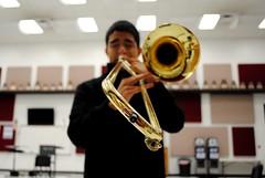 tuba(0.0), saxophone(0.0), musician(1.0), trumpet(1.0), trombone(1.0), music(1.0), brass instrument(1.0), wind instrument(1.0),