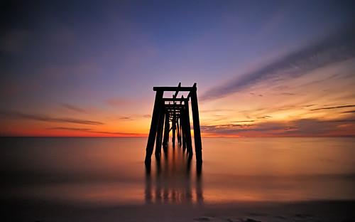 ocean longexposure sunset sky reflection beach gulfofmexico nature water silhouette landscape pier nikon glow gulf florida dusk decay vibrant smooth vivid shore fl bluehour panamacity panhandle 2010 d300 floridapanhandle camphelen tokina1116