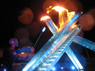 Spider-Man tries to roast marshmallows over the Vancouver 2010 Winter Olympics Cauldron
