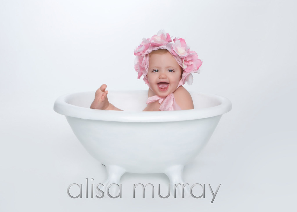 Artistic Baby photo with flowers in bath tub