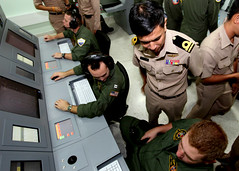 In this U.S. Navy file photo from a previous Cooperation Afloat Readiness and Training (CARAT) exercise, U.S. Navy P-3C Orion crew members train with Royal Thai Navy counterparts.