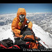 Climber on the summit of Everest with oxygen mask