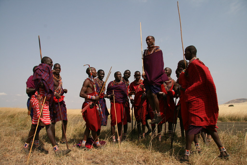Kamunu Saitoti, winner of the 'Most Improved Lion Guardian' award, is shown here jumping to celebrate.  In the Maasai culture, it is traditional for men to engage in this competitive jumping activity, which is used to show the murrans, or warriors', stamina and strength...and to impress the girls! Kamunu is showing how high he can jump and having a great time in the process.   Learn more about the joint Panthera/Living with Lions Lion Guardians program at www.panthera.org/programs/lion/lion-guardians  © Kylie McQualter