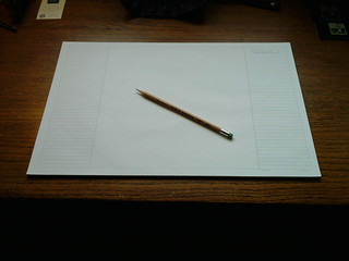 Blank paper on workspace for productive work