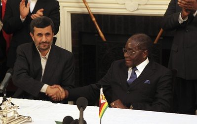 Iranian President Mahmoud Ahmadinejad, left, and Zimbabwean President Robert Mugabe shake hands, after addressing a press conference after signing a memorandum of understanding between Iran and Zimbabwe at State House in Harare, Thursday, April 22, 2010. by Pan-African News Wire File Photos