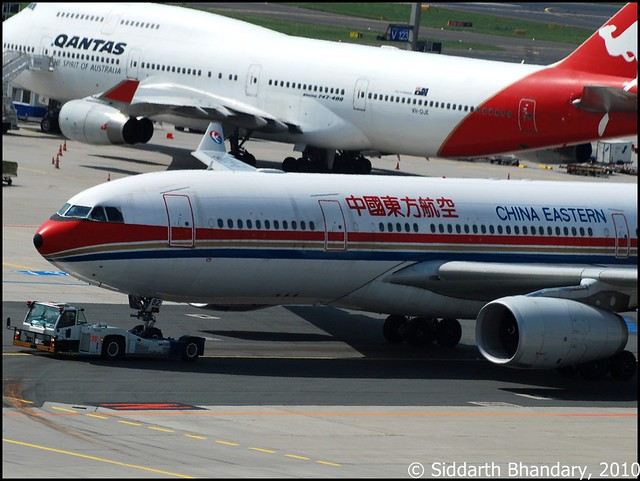 China Eastern A330-200 is towed using the lift truck