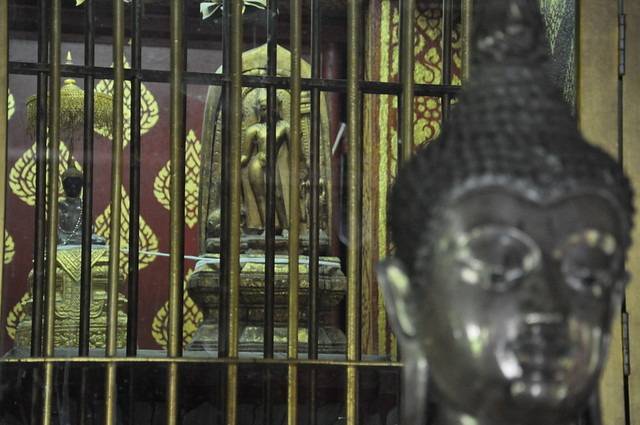 The Crystal & Marble Buddhas; Behind Bars
