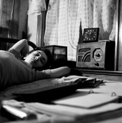 Esther Bubley: A radio is company for this girl in her boardinghouse room, Washington, D.C., 1943