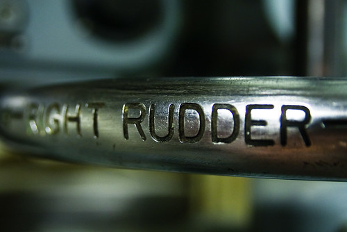 a metal handle with the word rudder etched in and clearly visible