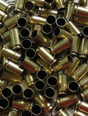 wheel(0.0), weapon(0.0), firearm(0.0), gun barrel(0.0), metal(1.0), ammunition(1.0),