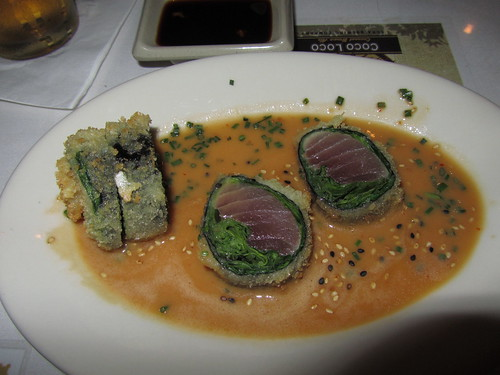Panko crusted ahi with arugula and spinach in a soy butter sauce.  MMMMMM!