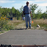 John Bird inspects the freshly finished tee pad on hole 10 at West Arvada Course.
