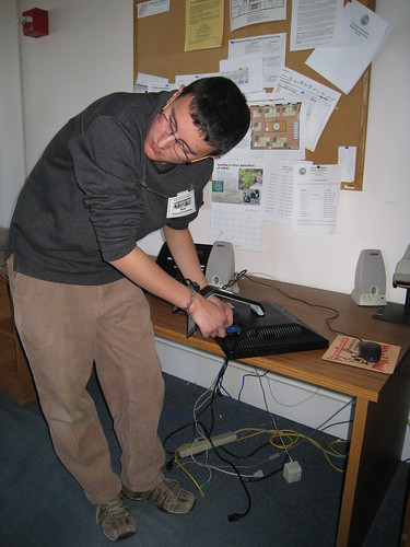Nick dismantles the workroom computers.