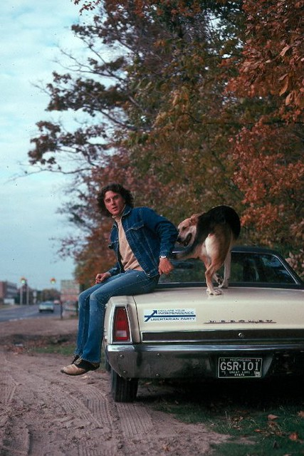 Bob Roddis and Greta at Michigan State - Fall 1974 with Nolan Chart on his car - On Farm Lane at Baker Woodlot looking north