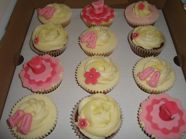 Vanilla and chocolate cupcakes with sugar decorations ballet shoes