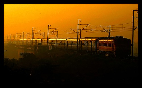 new morning sunlight india electric train canon river golden is moving long painted delhi capital north traction central tracks fast powershot viaduct east route journey rails express assam barrage freshly guwahati lucknow ending kanpur cnb vaishali bihar indianrailways 22314 uttarpradesh hindon 2506 ghaziabad irfca 2553 22602 22545 wap4 sx10 barauni