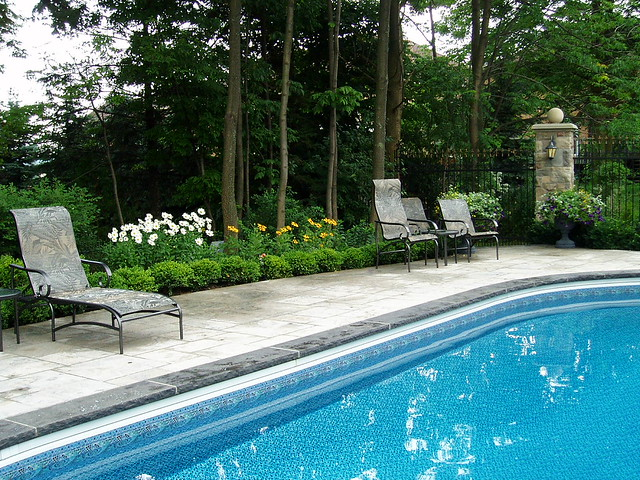 Landscaping around the pool pool landscaping creates for Garden designs around pools