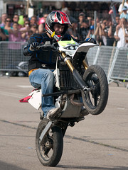 racing(1.0), freestyle motocross(1.0), vehicle(1.0), race(1.0), motorcycle(1.0), road racing(1.0), extreme sport(1.0), motorcycling(1.0), supermoto(1.0), stunt performer(1.0), person(1.0), stunt(1.0),