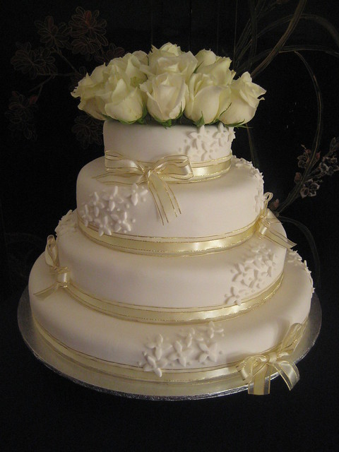 4 tier white gold wedding cake