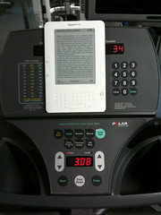 Reading my Kindle on the stair stepper at the gym