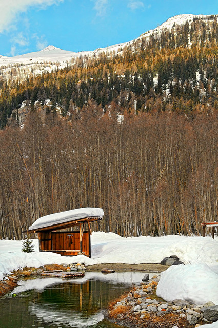 Small wooden caban and snow