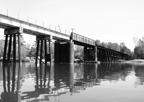 sanjacintoriver bridge railroad train kayak perceptionmirage perceptionkayak harriscounty humble texas houston cmwd cmwdblackandwhite black white bw blackwhite blackandwhite pontist supports united states north america