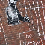 Banksy in Boston: Detail of the NO LOITRIN piece on Essex St in Central Square, Cambridge