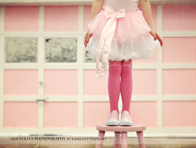 Standing on a Pink stool, wearing pink shoes, pink socks, a pink tutu, in front of a pink house... This is a true story! HBM