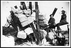 Two jolly Jocks sitting on a very smashed up strong position of the Germans