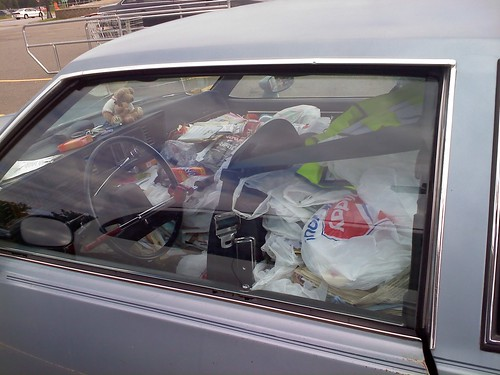 Parked next to a hoarder.