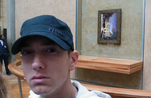 THE MONA LISA IS REPLACED BY A THOMAS KINKADE PAINTING HANGING THE WRONG WAY